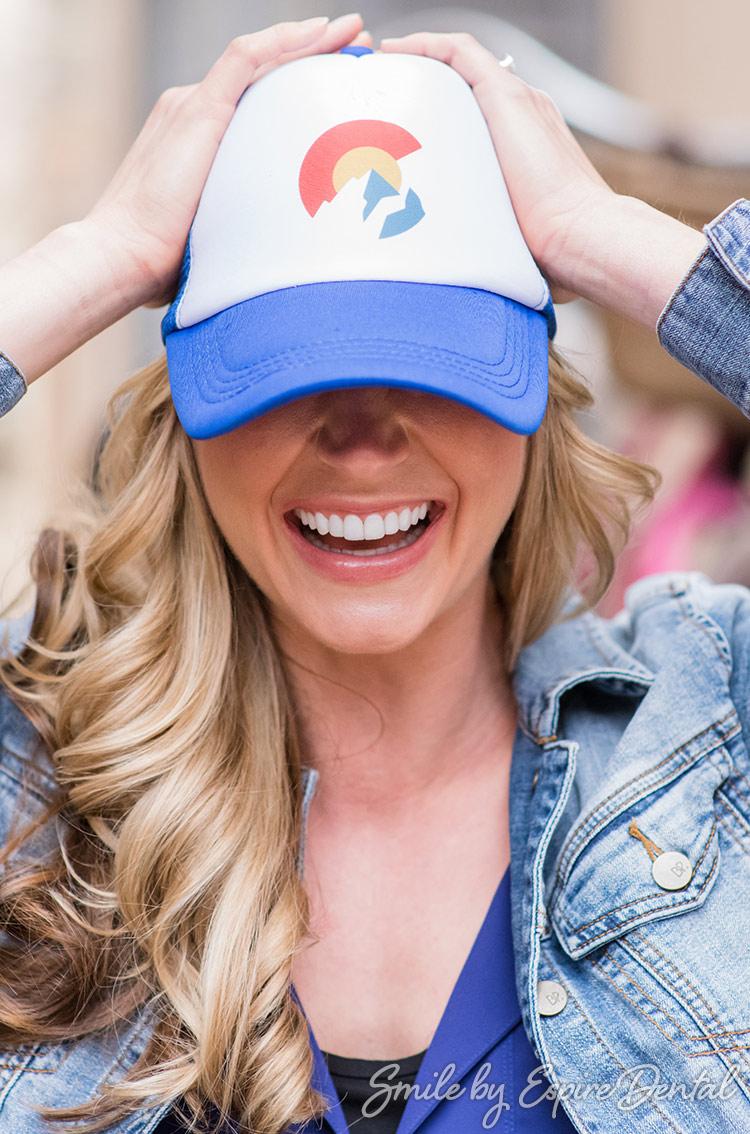 Smiling woman wearing Colorado hat